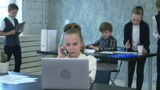 Group of little business kids working in the office