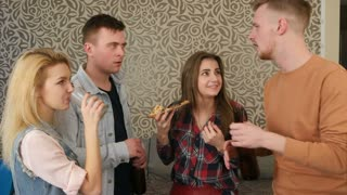 Group of young friends talking and flirting at a house party