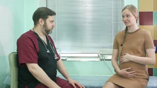 Gynecologist doctor with pregnant woman meeting at hospital
