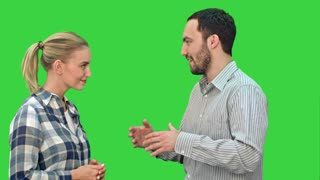 Handsome man and attractive young woman talking and smiling on a Green Screen, Chroma Key