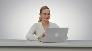 Happy businesswoman enjoy working on laptop computer, imagine the project and write down on white background