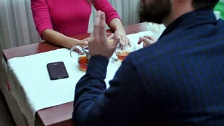 Happy couple with wallet paying bill at restaurant with dollar cash