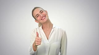 Happy excited woman showing approval hand gesture thumb up and smiling on white background