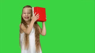 Happy smiling girl holding gift box on a Green Screen, Chroma Key
