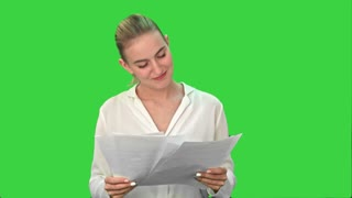 Happy woman finish project and throws scraps of paper on a Green Screen, Chroma Key