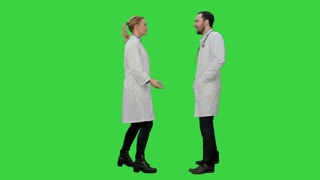 Happy young medical students dancing, celebrating they pass exam on a Green Screen, Chroma Key