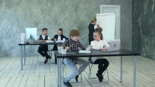 Little business kids having busy day in office