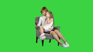 Little girl and her mother taking selfie on a Green Screen, Chroma Key