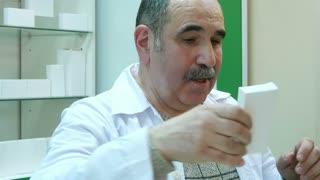 Male customer buy tablet pay with dollars cash at pharmacy counter
