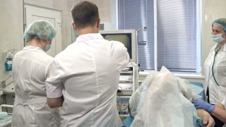 Male surgeon controlling endoscopy surgery