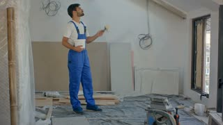 Man as construction worker building house and carrying wood