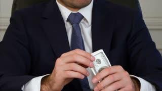 Man's hands holding money dollar bills