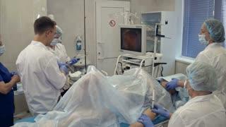 Medical team conducting surgery using endoscope