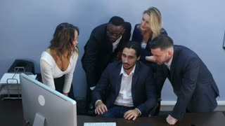 Multiracial business team celebrating success in office