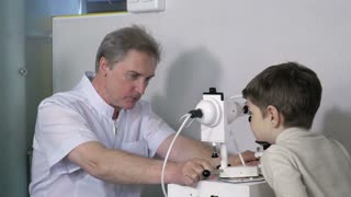 Optometrist checking little child vision
