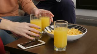 Orange juice with chips on the table in student house