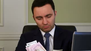 Portrait of a businessman counting money