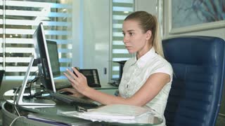 Portrait of young unhappy business woman at desk in office