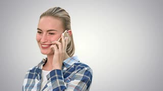 Pretty woman in casual clothes talking on the phone and smiling on white background