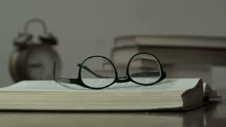Reading glasses on the opened book