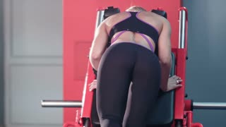 Sexy girl butt workout in the gym