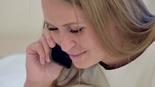 Smiling female talking on the phone