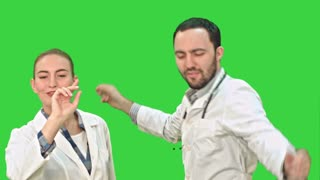 Smiling young woman and man in lab coat making funny dance on a Green Screen, Chroma Key