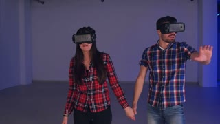 Surprised couple experiencing virtual reality simulation