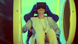 Surprised young female experiencing virtual reality for the first time