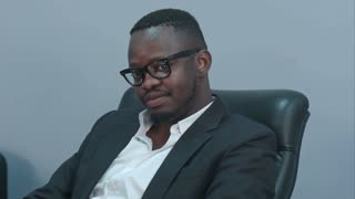 Thoughtful african american businessman sitting in office