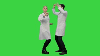Two funny medical doctors with funny energy dance on a Green Screen, Chroma Key