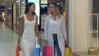Two lovely ladies enjoying their shopping weekend