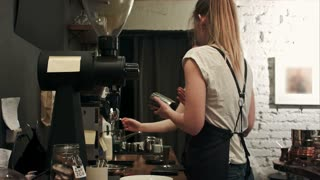 Two young female barista working in coffee shop, pareparing coffee
