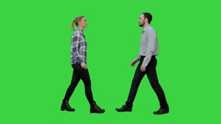 Two young people shake hands keep silent on a Green Screen, Chroma Key