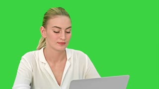Woman boss tired at the end of working day, yawning and sleeping on a Green Screen, Chroma Key