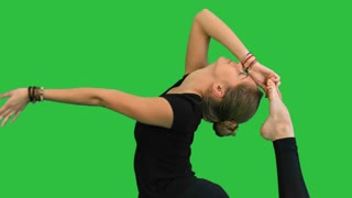 Woman doing stretching exercises, practicing yoga on a Green Screen, Chroma Key