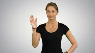 Woman with Namaste Mudra gesture meditating with closed eyes on white background