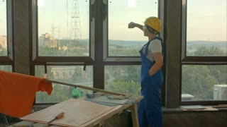 Worker taking break from work at window and look into the distance