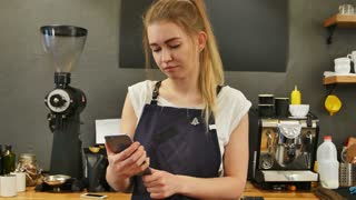 Youg female barista taking selfie at work place