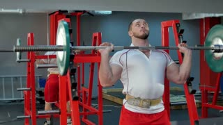 Young bodybuilder doing weight lifting in the gym
