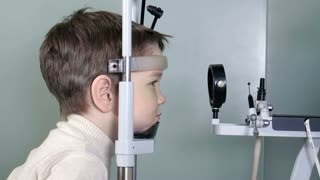 Young boy patient is having a medical attendance at the optometrist