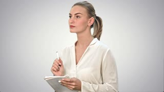 Young business woman inventing ideas, writing the, down to the notebook on white background