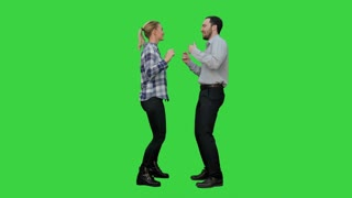 Young couple dancing together on a Green Screen, Chroma Key
