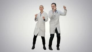 Young doctors in a good mood dancing and singing songs on white background