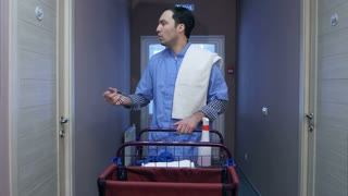 Young housekeeping worker offering cleaning services for hotel guests