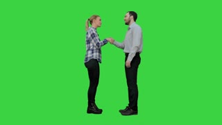 Young people happy to meet each other handshaking on a Green Screen, Chroma Key