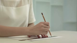 Woman architect drawing line on a ruler