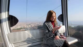 Woman communicate by phone in funicular