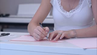 Woman drawing butterfly with paper template
