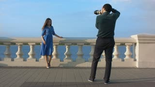Woman in blue dress posing for photographer